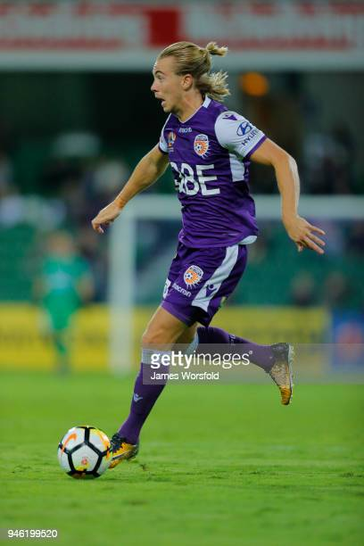 Joseph Mills of the Perth Glory runs along the side of the pitch with the ball during the round 27 ALeague match between the Perth Glory and the...
