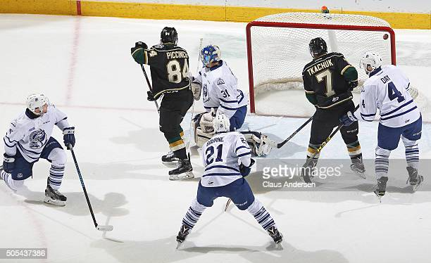 Joseph Murdaca of the Mississauga Steelheads lets a shot by Christian Dvorak of the London Knights get by him during an OHL game at Budweiser Gardens...