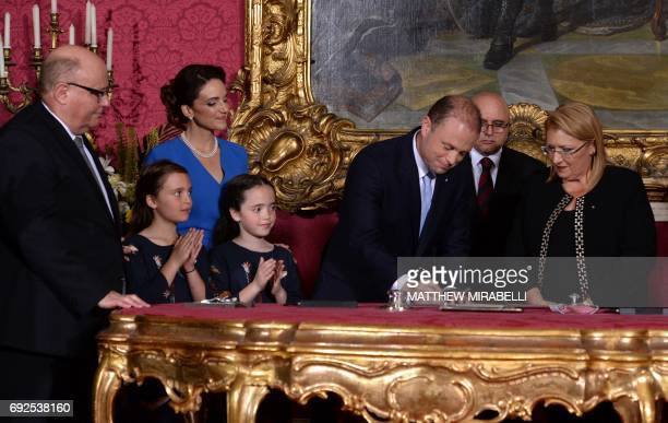 Joseph Muscat accompanied by his wife Michelle Muscat and two daughters is sworn in as Prime Minister of Malta by President of Malta Marie Louise...