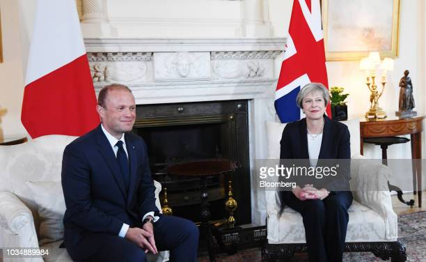 Joseph Muscat Malta's prime minister left and Theresa May UK prime minister sit for a photograph during a meeting inside number 10 Downing Street in...