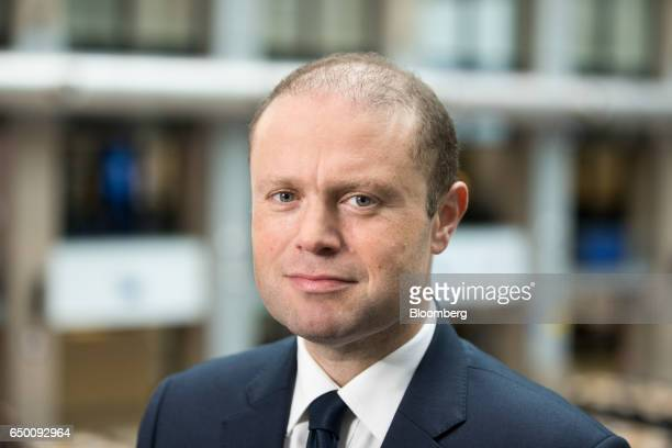 Joseph Muscat Malta's prime minister poses for a photograph before a Bloomberg Television interview at a European Union summit in Brussels Belgium on...