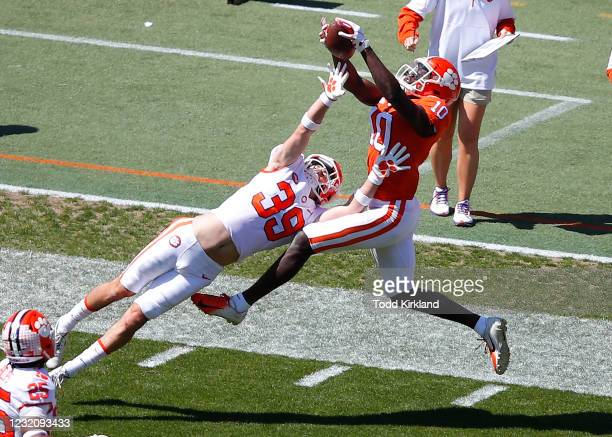 Joseph Ngata of the Clemson Tigers leaps for the catch as Bubba McAtee defends during the second half of the Clemson Orange and White Spring Game at...