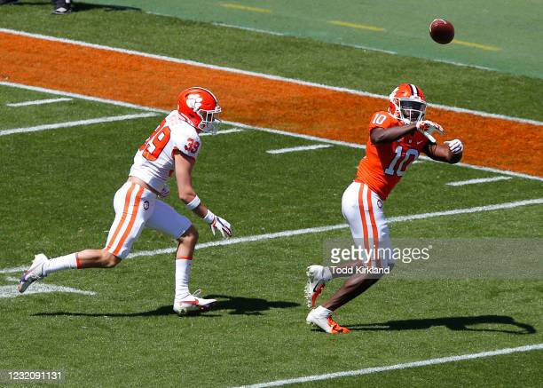 Joseph Ngata of the Clemson Tigers makes a reception as Bubba McAtee of the Clemson Tigers defends during the Clemson Orange and White Spring Game at...
