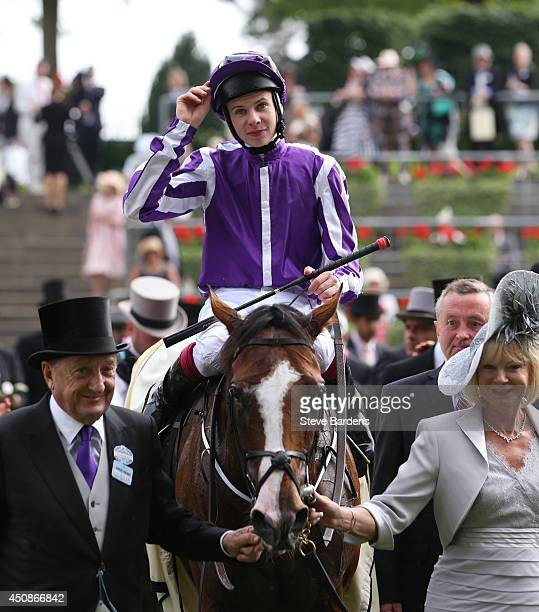 Joseph O'Brien celebrates as he enters the parade ring after his victory riding Leading Light in the Gold Cup on day three of Royal Ascot at Ascot...