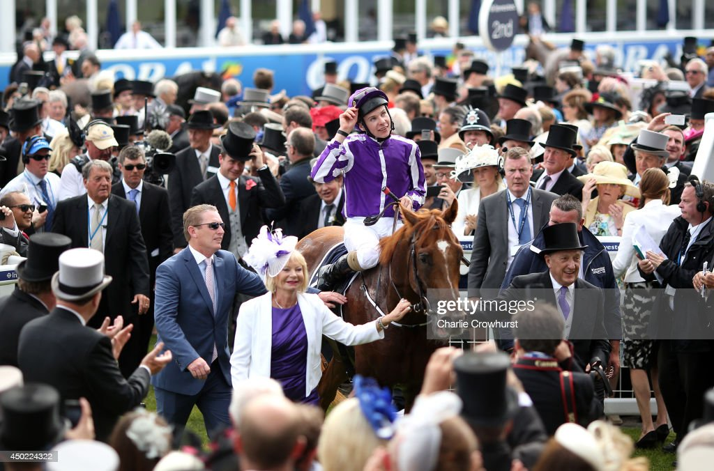 Joseph O'Brien celebrates with Australia as they are lead into the winners enclosure after winning The Investec Derby at Epsom racecourse on June 07, 2014 in Epsom, England.