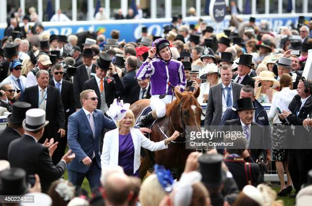 Joseph O'Brien celebrates with Australia as they are lead into the winners enclosure after winning The Investec Derby at Epsom racecourse on June 07,...