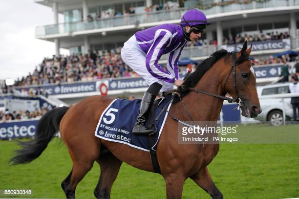 Joseph O'Brien rides St Nicholas Abbey to post for the Investec Coronation Cup on the Investec Derby Day at Epsom Downs Racecourse Surrey PRESS...