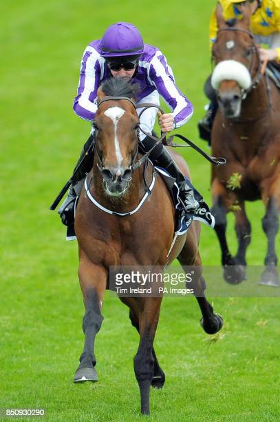 Joseph O'Brien rides St Nicholas Abbey to win the Investec Coronation Cup on the Investec Derby Day at Epsom Downs Racecourse Surrey