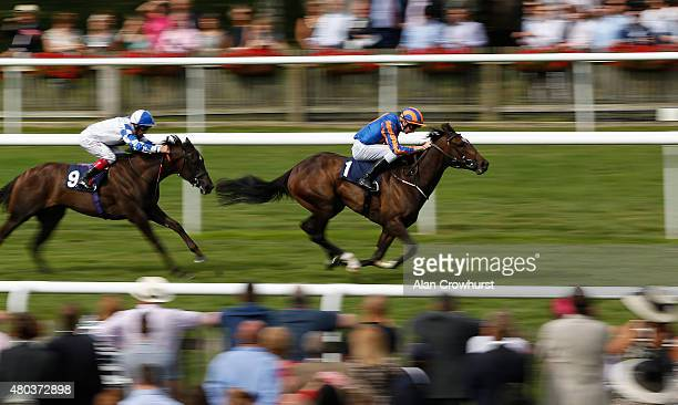 Joseph O'Brien riding Ballydoyle win The Rossdales EBF Stallions Maiden Filleis' Stakes at Newmarket racecourse on July 11 2015 in Newmarket England
