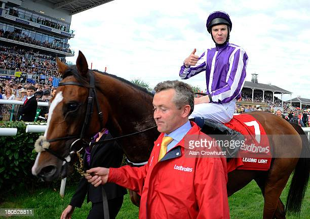 Joseph O'Brien riding Leading Light win The Ladbrokes St Leger at Doncaster racecourse on September 14, 2013 in Doncaster, England.
