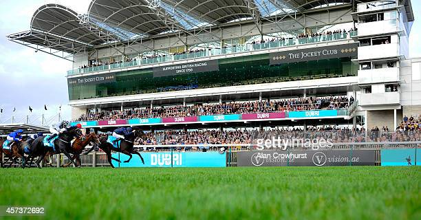 Joseph O'Brien riding Together Forever win The Dubai Fillies' Mile at Newmarket racecourse on October 17 2014 in Newmarket England