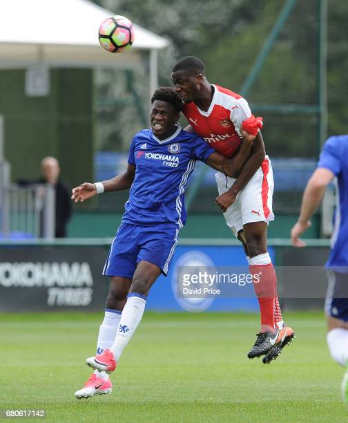Joseph Olowu of Arsenal heads the ball under pressure from Ike Ugbo of Chelsea during the U18 Premier League match between Chelsea and Arsenal at...