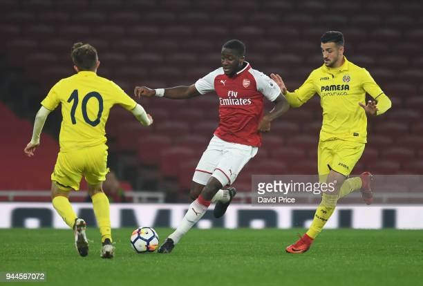 Joseph Olowu of Arsenal takes on Ruben Mesa Visiga of Villarreal during the match between Arsenal U23 and Villarreal U23 at Emirates Stadium on April...