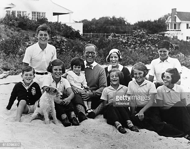 Joseph P. And Rose Kennedy pose for a picture on the beach at Hyannis Port, Massachusetts with their eight children.