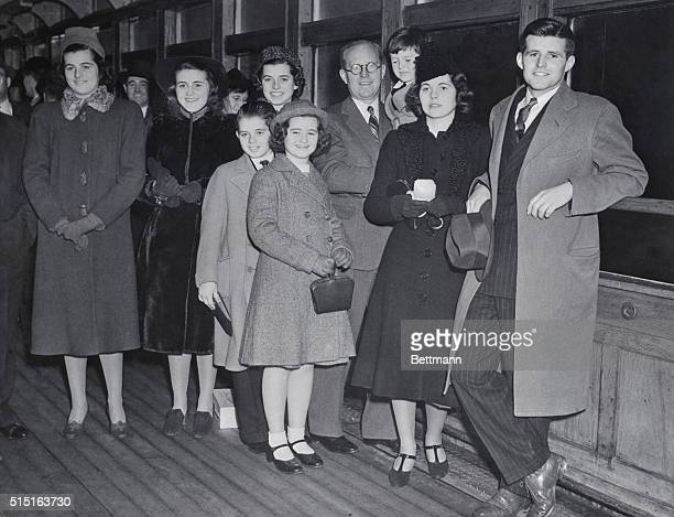 Joseph P. Kennedy, former head of the Maritime Commission and the new United States Ambassador to Great Britain, with eight of his nine children who...