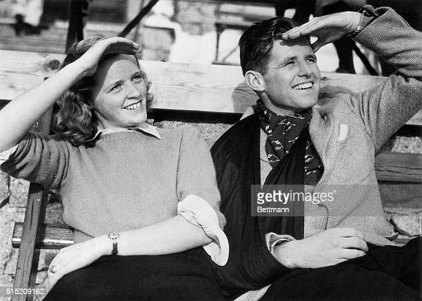 Joseph P Kennedy Jr and Patricia MacDonald watch skaters at the Suvretta Rink in St Moritz Kennedy is on the sidelines due to an arm injury he...