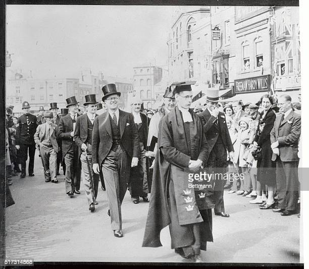 Joseph P Kennedy United States Ambassador to Great Britain smiles broadly as he walks in the procession to the famous Stump Church here during the...