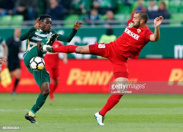 Joseph Paintsil of Ferencvarosi TC battles for the ball with Dejan Karan of DVTK during the Hungarian OTP Bank Liga match between Ferencvarosi TC and...