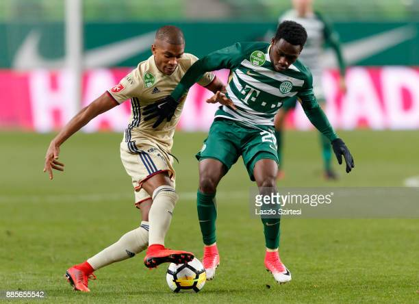 Joseph Paintsil of Ferencvarosi TC competes for the ball with Loic Nego of Videoton FC during the Hungarian OTP Bank Liga match between Ferencvarosi...