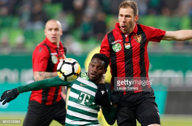 Joseph Paintsil of Ferencvarosi TC fights for the ball with Ivan Lovric of Budapest Honved during the Hungarian OTP Bank Liga match between...