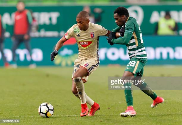 Joseph Paintsil of Ferencvarosi TC fights for the ball with Loic Nego of Videoton FC during the Hungarian OTP Bank Liga match between Ferencvarosi TC...