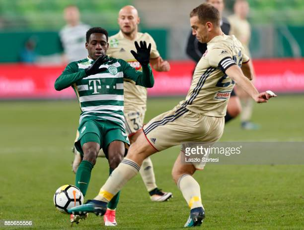 Joseph Paintsil of Ferencvarosi TC fights for the ball with Roland Juhasz of Videoton FC during the Hungarian OTP Bank Liga match between...