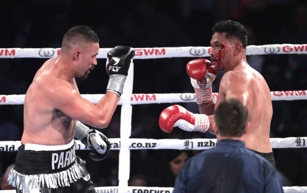 Joseph Parker and Junior Fa with a bloodied face trade punches during the heavyweight bout between Joseph Parker and Joshua Fa at Spark Arena on...
