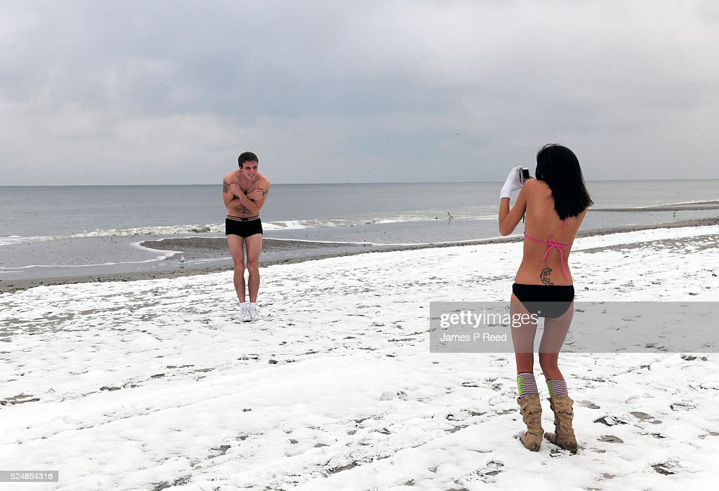 Joseph Parker And Samantha Wiegand Brave Unusually Cold Temperatures A Rare Snowfall At Myrtle Beach