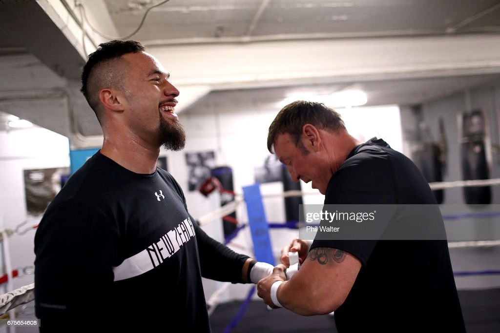 Joseph Parker (L) has his hands wrapped by trainer Kevin Barry (R) before a training session on May 2, 2017 in Auckland, New Zealand. Parker will fight Razvan Cojanu in Auckland on Saturday.