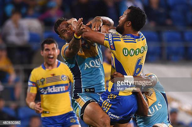 Joseph Paulo of the Eels is tackled by Josh Hoffman of the Titans during the round 21 NRL match between the Gold Coast Titans and the Parramatta Eels...