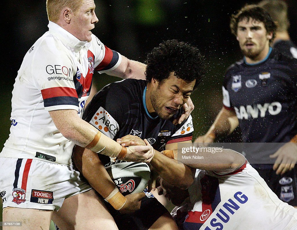 Joseph Paulo of the Panthers is tackled during the round 11 NRL match between the Penrith Panthers and the Sydney Roosters at CUA Stadium on May 23, 2009 in Sydney, Australia.