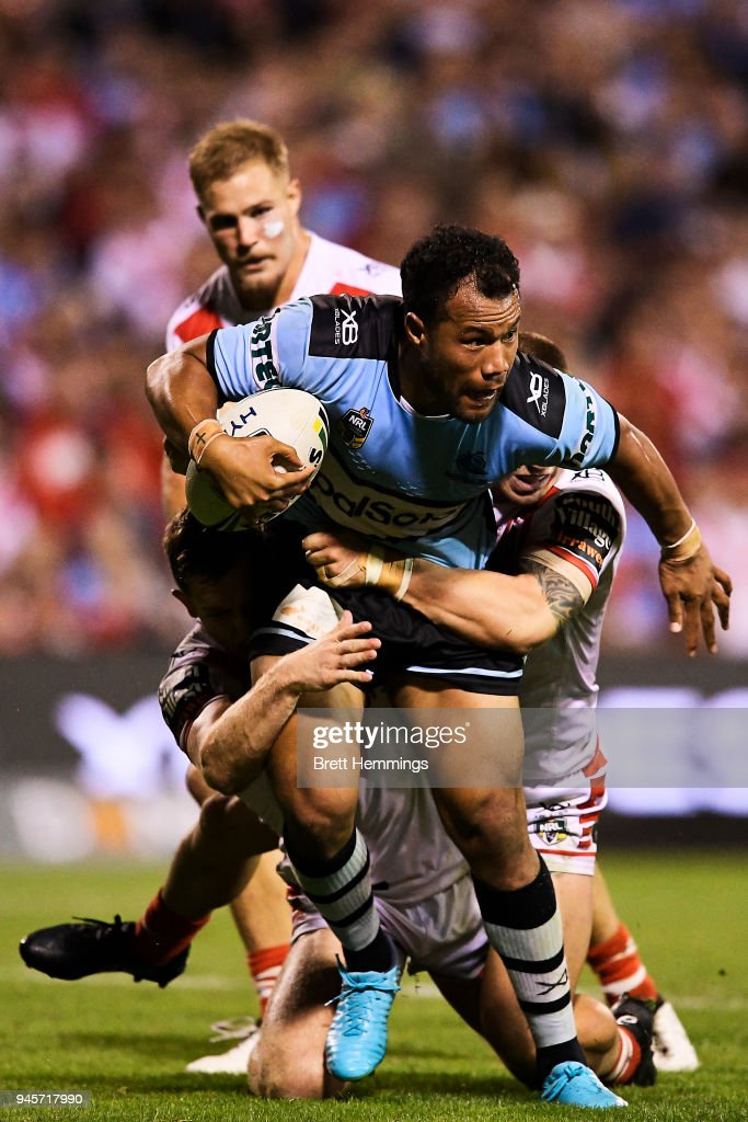 Joseph Paulo of the Sharks is tackled during the round six NRL match between the St George Illawarra Dragons and the Cronulla Sharks at WIN Stadium on April 13, 2018 in Wollongong, Australia.