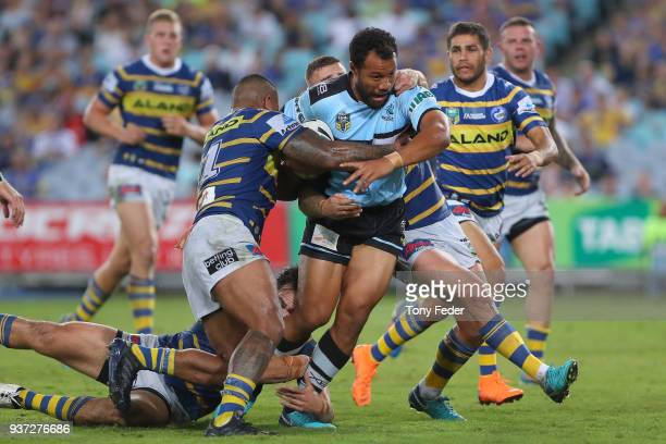 Joseph Paulo of the Sharks is tackled during the round three NRL match between the Parramatta Eels and the Cronulla Sharks at ANZ Stadium on March 24...