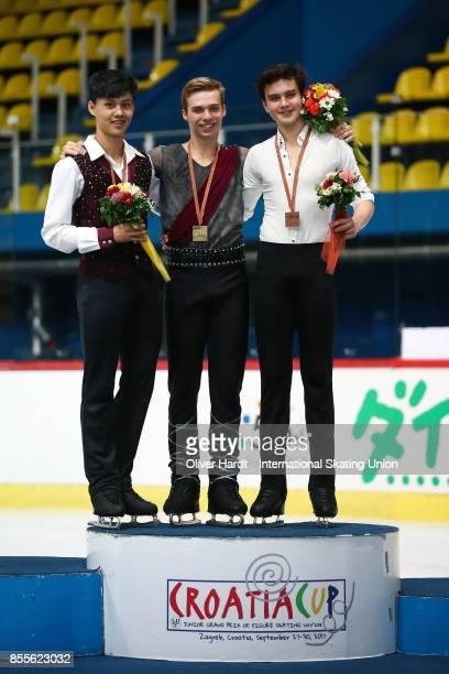 Joseph Phan of Canada with the silver medal, Alexei Krasnozhon of United States with the gold medal and Makar Ignatov of Russia with the bronze medal...