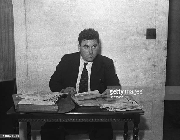 Joseph R Brodsky defense counsel reading affidavits at the preliminary hearing on the retrial of the Scottsboro case defendants is shown Maneuvering...