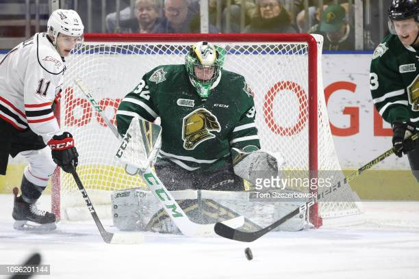 Joseph Raaymakers of the London Knights keeps his eyes on a puck in front of the net in the first period during OHL game action against the Owen...