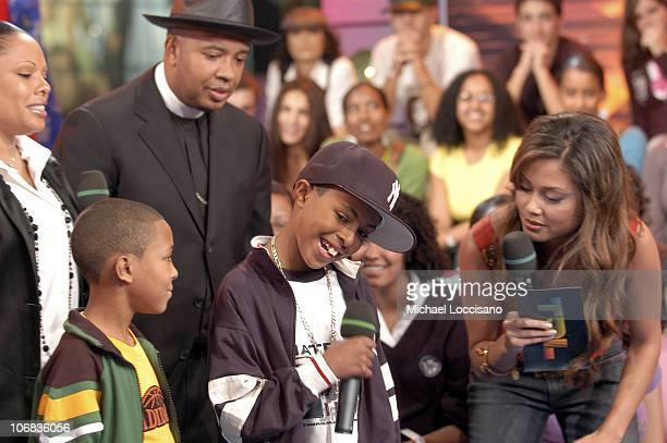 Joseph Reverend Run Simmons with family and MTV VJ Vanessa Minnillo
