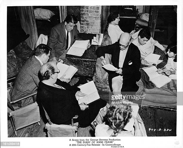 Joseph Schildkraut Millie Perkins and the rest of the cast read their scripts on set of the film 'The Diary Of Anne Frank' 1959