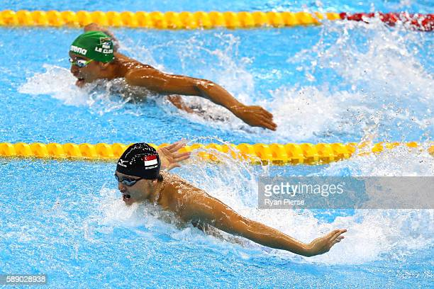 Joseph Schooling of Singapore and Chad Guy Bertrand le Clos of South Africa swim in the Men's 100m Butterfly Final on Day 7 of the Rio 2016 Olympic...