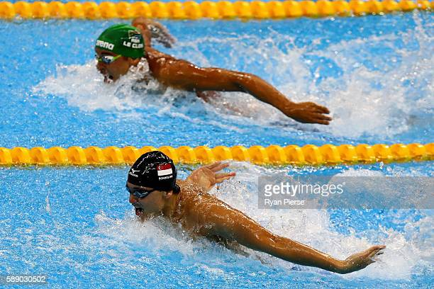 Joseph Schooling of Singapore and Chad Guy Bertrand le Clos of South Africa [top] swim in the Men's 100m Butterfly Final on Day 7 of the Rio 2016...