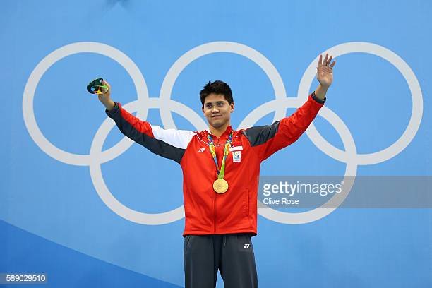 Joseph Schooling of Singapore celebrates winning the gold medal in the Men's 100m Butterfly Final on Day 7 of the Rio 2016 Olympic Games at the...