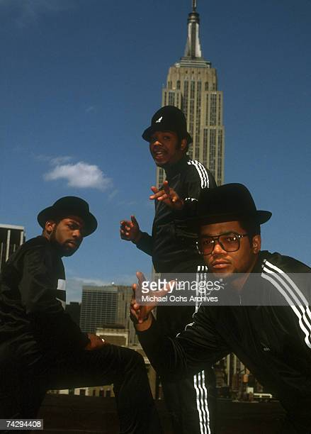 Joseph Simmons Darryl McDaniels and Jam Master Jay of the hiphop group Run DMC pose for a portrait session wearing Addidas sweat suits in front of...