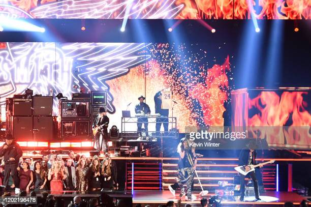 Joseph Simmons of music group Run–DMC while Brad Whitford Steven Tyler and Joe Perry of music group Aerosmith perform onstage during the 62nd Annual...