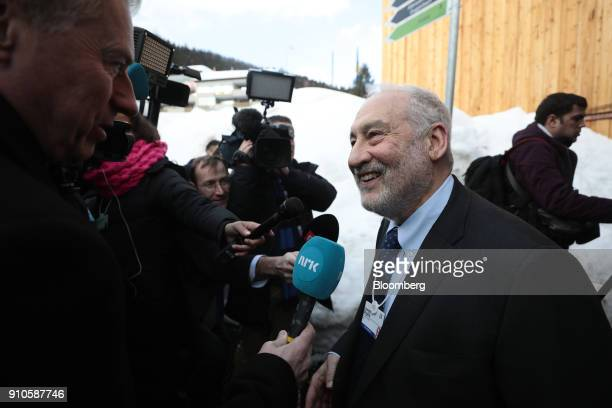 Joseph Stiglitz economics professor at Columbia University right speaks to members of the media following the special address by US President Donald...