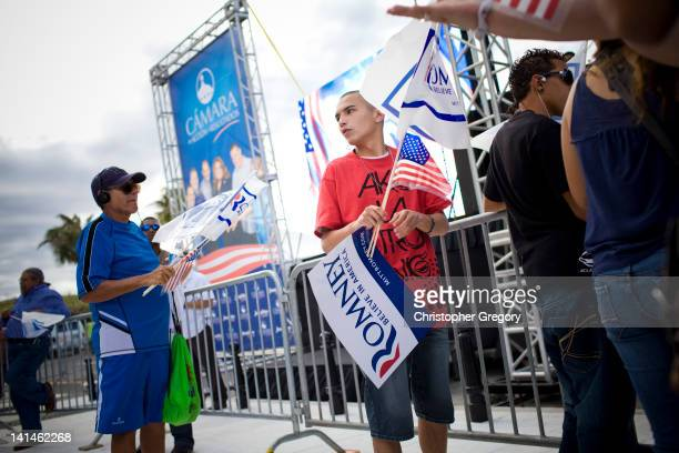 Joseph Sudol sells flags at a New Progressive Party rally where Republican presidential candidate former Massachusetts Gov Mitt Romney was...