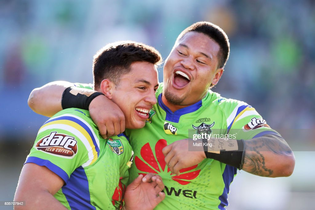 Joseph Tapine of the Raiders (L) celebrates with Joseph Leilua (R) after scoring a try during the round 24 NRL match between the Canberra Raiders and the Penrith Panthers at GIO Stadium on August 20, 2017 in Canberra, Australia.