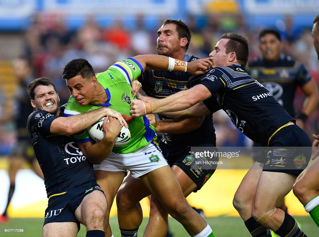 Joseph Tapine of the Raiders is wrapped up by the Cowboys defence during the round one NRL match between the North Queensland Cowboys and the Canberra Raiders at 1300SMILES Stadium on March 4, 2017 in Townsville, Australia.