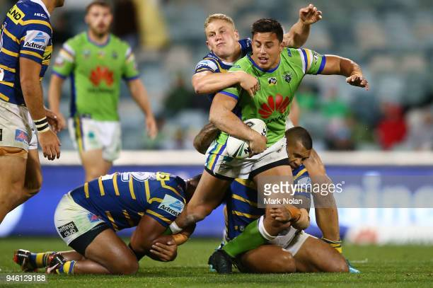 Joseph Tapine of the Raiders looks for support as he is tackled during the round six NRL match between the Canberra Raiders and the Parramatta Eels...
