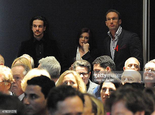 Joseph Timms Finty Williams and Dr Christian Jessen attends the Terrence Higgins Trust Auction at Christie's on March 12 2014 in London England