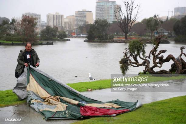 Joseph Tipalla folds his tent as he prepares to move from a homeless camp at Lakeside Park on Thursday Feb 14 in Oakland Calif The city of Oakland...